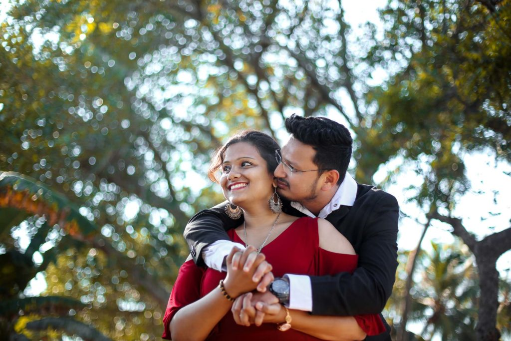 Bride and Groom looking great in a Solid Maroon and Navy Combination for their post wedding photoshoot