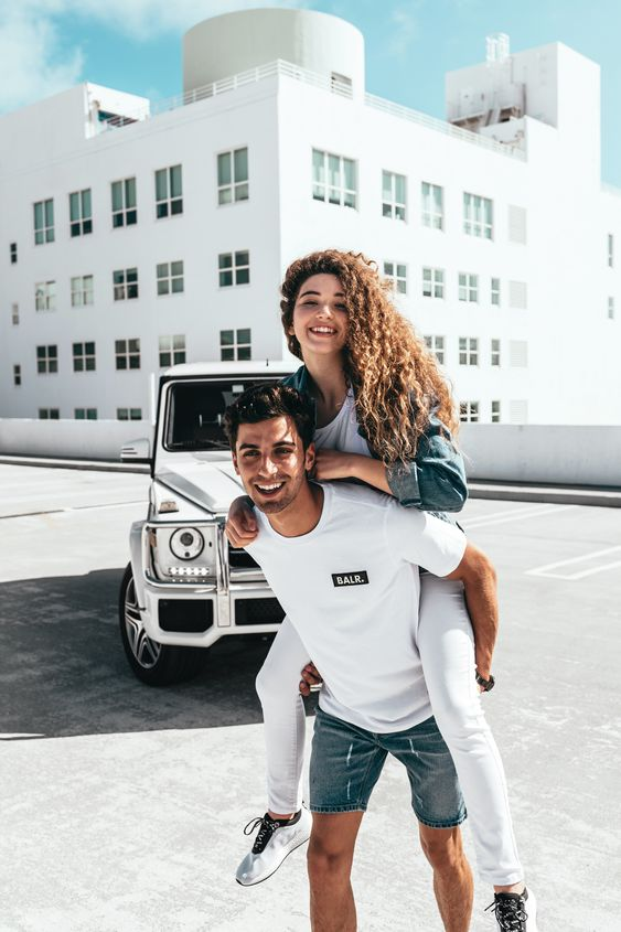 Couple wearing a classic combination of White and Denim outfit for their photoshoot